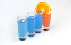 Beautiful row line of different colored alcohol cocktails Royalty Free Stock Image