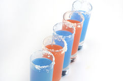 Beautiful row line of different colored alcohol cocktails Royalty Free Stock Photo