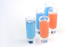 Beautiful row line of different colored alcohol cocktails Stock Photos
