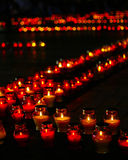 Beautiful row of red funeral candles. Big beautiful row of red funeral candles shot at night with shallow depth of field and blurred background Royalty Free Stock Images