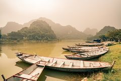 Rafts await villagers by the lake in Vietnam Royalty Free Stock Image