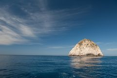 A small rock off the coast of zakynthos. Beautiful Royalty free stock photo. a small rock off the coast of zakynthos Royalty Free Stock Photos