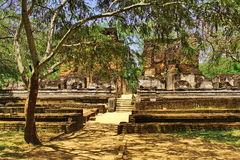 Beautiful ruines of exotic ancient hinduist temple. Beautiful view on way in old exotic ruines of ancient hinduist temple Stock Image
