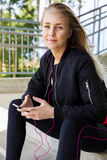 Beautiful Runner In Sportswear Listening Music On Smartphone Stock Photos