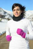 Beautiful runner on winter snow mountain Stock Photography