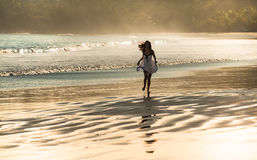 Beautiful running on a beach. Royalty Free Stock Photography