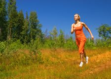 Beautiful running girl. Beautiful girl running in the forest Royalty Free Stock Photos
