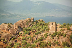 Beautiful rural landscape with abandoned ruins of Byzantine town over the lake Bafa, nature reserve of Turkey Stock Photography