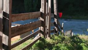 Beautiful rural landscape with old wooden fence, mountain view on horizon and blue cloudy sky. natural summer background stock footage