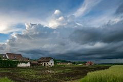 A menacing looking storm above the green fields of the Mures Valley, Romania. royalty free stock photo
