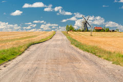 Beautiful rural landscape with a windmill Stock Images