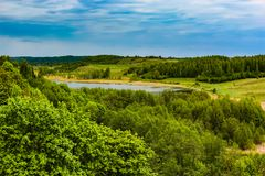 Beautiful rural summer landscape with forest, river, blue sky and white clouds royalty free stock images
