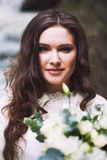 Beautiful Russian girl with a bridal bouquet of flowers. Beautiful Russian attractive girl with a bridal bouquet of flowers Royalty Free Stock Photography