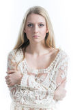 Beautiful Russian blonde girl on a white background in a white translucent blouse Stock Image