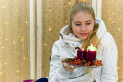 Beautiful Russian girl on the background of Christmas garland. Royalty Free Stock Photo