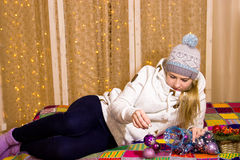 Beautiful Russian girl on the background of Christmas garland. Stock Photo