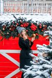 Beautiful russian girl in a cloud day in winter walking in Tverskaya Square in Christmas time. Beautiful russian girl in a cloud day in winter style clothes royalty free stock photos