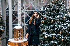 Beautiful russian girl in a cloud day in winter walking in Tverskaya Square in Christmas time. Beautiful russian girl in a cloud day in winter style clothes stock image