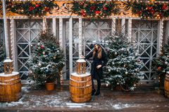 Beautiful russian girl in a cloud day in winter walking in Tverskaya Square in Christmas time. Beautiful russian girl in a cloud day in winter style clothes stock photos