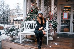 Beautiful russian girl in a cloud day in winter walking in Tverskaya Square in Christmas time. Beautiful russian girl in a cloud day in winter style clothes royalty free stock photography