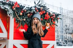 Beautiful russian girl in a cloud day in winter walking in Tverskaya Square in Christmas time. Beautiful russian girl in a cloud day in winter style clothes stock photo