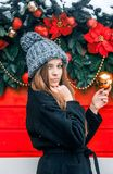 Beautiful russian girl in a cloud day in winter walking in Tverskaya Square in Christmas time. Beautiful russian girl in a cloud day in winter style clothes royalty free stock images