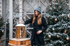 Beautiful russian girl in a cloud day in winter walking in Tverskaya Square in Christmas time. Beautiful russian girl in a cloud day in winter style clothes royalty free stock photo