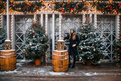 Beautiful russian girl in a cloud day in winter walking in Tverskaya Square in Christmas time. Beautiful russian girl in a cloud day in winter style clothes stock images