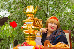 Beautiful Russian girl with a curvaceous, rosy and happy sitting Stock Photography