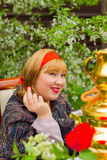 Beautiful Russian girl with a curvaceous, rosy and happy sitting Royalty Free Stock Images