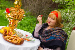 Beautiful Russian girl with a curvaceous, rosy and happy sitting Royalty Free Stock Image