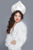 Beautiful Russian girl model in fur coat and exclusive design cl. Othes on manners old-Slavic. Close-up portrait Royalty Free Stock Photography