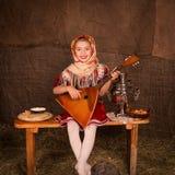 Beautiful russian girl in a shawl Royalty Free Stock Photo