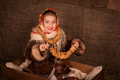 Beautiful russian girl in a shawl  sitting in a cart Royalty Free Stock Photos
