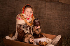 Beautiful russian girl in a shawl  sitting in a cart Stock Photography