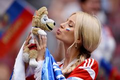 Beautiful Russian lady kissing World Cup mascot Zabivaka before FIFA World Cup 2018 Round of 16 match Spain vs Russia stock photos