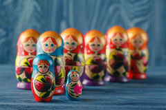 Beautiful Russian matreshka doll on blue wooden background Royalty Free Stock Image