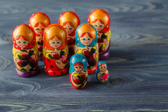 Beautiful Russian matreshka doll on blue wooden background Royalty Free Stock Photo