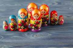 Beautiful Russian matreshka doll on blue wooden background Stock Images