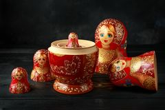 Beautiful Russian traditional nesting dolls matreshka on rustic background royalty free stock images