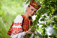 Beautiful Russian woman in national clothes Stock Images