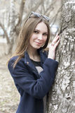 The beautiful Russian woman poses in the park. Royalty Free Stock Image