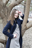 The beautiful Russian woman poses in the park. Stock Photos
