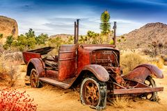 Beautiful Rusted Old Car in the Desert. Amazing texture on the rusted out old car in Joshua Tree Royalty Free Stock Photos