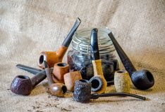 Rustic pipe collection on burlap royalty free stock image