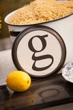 Rustic table setting with lettered plate. Beautiful rustic table setting with the letter `G` incorporated Stock Image