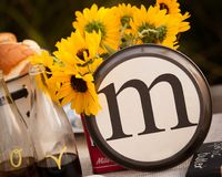 Rustic Table setting with lettered M Plate. Beautiful rustic table setting with the letter M incorporated Royalty Free Stock Photos