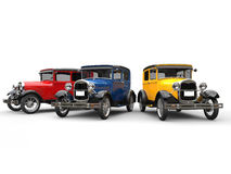 Beautiful 1920s vintage cars in blue, red and yellow. Isolated on white background Royalty Free Stock Images