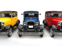 Beautiful 1920s vintage cars in primary colors - cut shot Stock Photos