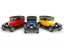 Beautiful 1920s vintage cars in primary colors. Isolated on white background Royalty Free Stock Photo